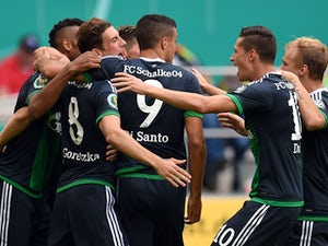 :Schalke�s players celebrate during the German Cup DFB Pokal first round football match between MSV Duisburg and Schalke 04 in Duisburg, western Germany on August 8, 2015.