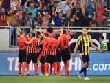 Shakhtar's players celebrate scoring a goal during the UEFA Champions League third qualifying round football match between FC Shakhtar Donetsk and Fenerbahce SC in Lviv on August 5, 2015