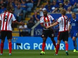 Jermain Defoe of Sunderland celebrates scoring his team's first goal with his team mate Sebastian Larsson and Jack Rodwell during the Barclays Premier League match between Leicester City and Sunderland at The King Power Stadium on August 8, 2015