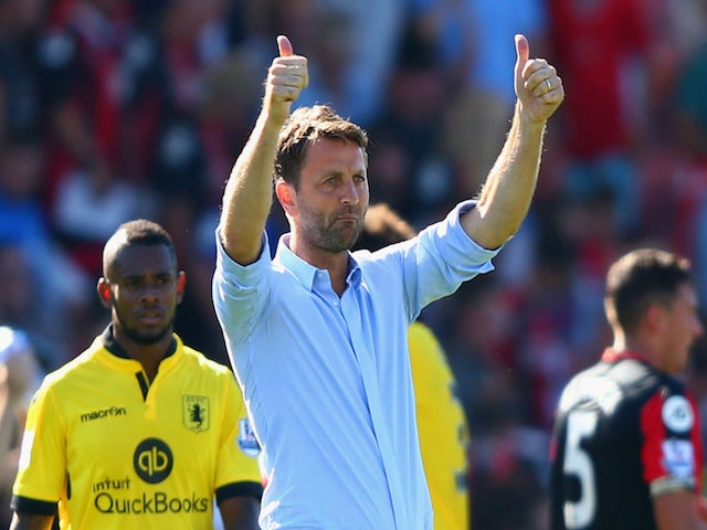 Tim Sherwood Manager of Aston Villa celebrates after his team's 1-0 win in the Barclays Premier League match between A.F.C. Bournemouth and Aston Villa at Vitality Stadium on August 8, 2015