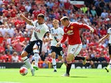 Kyle Walker (L) of Tottenham Hotspur kicks the ball resulting in the own goal during the Barclays Premier League match between Manchester United and Tottenham Hotspur at Old Trafford on August 8, 2015