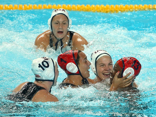 Samantha Hill #1 and Ashleigh Johnson #13 of the United States celebrate with their teammates after winning the gold medal match to defeat the Netherlands 5 to 4 on day fourteen of the 16th FINA World Championships at the Water Polo Arena on August 7, 201