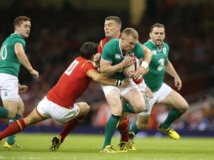 Keith Earls of Ireland is tackled by James Hook and Scott Williams during the International match between Wales and Ireland at the Millennium Stadium on August 8, 2015