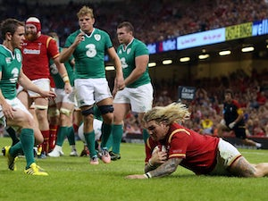 Wales's hooker Richard Hibbard scores a try during the 2015 Rugby World Cup warm up rugby union match between Wales and Ireland at The Millennium Stadium in Cardiff, south Wales on August 8, 2015. The 2015 Rugby World Cup begins on September 18, 2015,