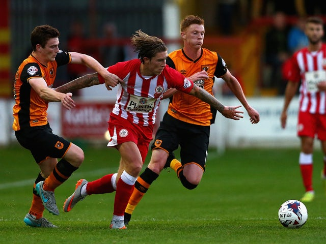 Josh Windass of Accrington Stanley in action with Andy Robertson and Sam Clucas of Hull City during the Capital One Cup First Round match between Accrington Stanley and Hull City at Wham Stadium on August 11, 2015