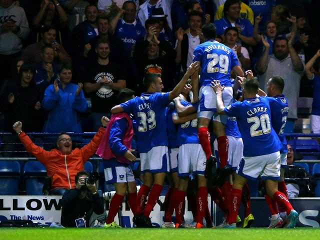 Adam McGurk of Portsmouth celebrates scoring a goal during the Capital One Cup First Round match between Portsmouth v Derby County at Fratton Park on August 12, 2015 in Portsmouth, England.