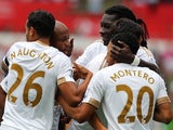 Andre Ayew is congratulated by teammates after scoring Swansea's second against Newcastle on August 15, 2015