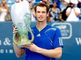 Andy Murray of Great Britain poses with the winner's trophy after defeating Novak Djokovic of Serbia during the final of the Western & Southern Open at the Lindner Family Tennis Center on August 21, 2011