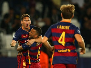 Lionel Messi of Barcelona is congratulated on scoring their first goal with Dani Alves of Barcelona during the UEFA Super Cup between Barcelona and Sevilla FC at Dinamo Arena on August 11, 2015