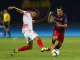Pedro of Barcelona evades a tackle from Vitolo of Sevilla during the UEFA Super Cup between Barcelona and Sevilla FC at Dinamo Arena on August 11, 2015