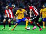 Pedro Rodriguez of FC Barcelona competes for the ball with Markel Susaeta (L) and Oscar de Marcos of Athletic Club during the Spanish Super Cup first leg match between FC Barcelona and Athletic Club at San Mames Stadium on August 14, 2015