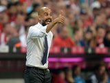 Bayern Munich's Spanish headcoach Pep Guardiola reacts during the German first division Bundesliga football match FC Bayern Munich vs Hamburger SV at the Allianz Arena in Munich, southern Germany, on August 14, 2015