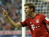 Bayern Munich's midfielder Thomas Muller celebrates scoring the 3-0 goal during the German first division Bundesliga football match FC Bayern Munich vs Hamburger SV at the Allianz Arena in Munich, southern Germany, on August 14, 2015