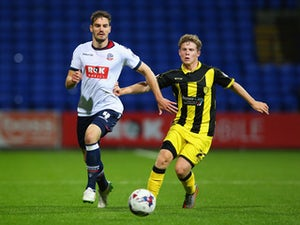 Burton knock out Bolton with Palmer strike