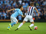 David Silva of Manchester City takes on James Morrison of West Bromwich Albion during the Barclays Premier League match between West Bromwich Albion and Manchester City at The Hawthorns on August 10, 2015
