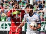 Bremen's goalkeeper Felix Wiedwald shoves Schalke's Dutch striker Klaas-Jan Huntelaar after conceding an own goal on August 15, 2015