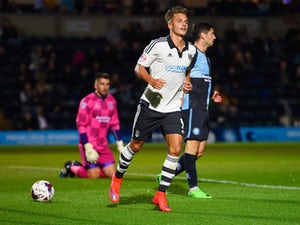 Despair for Wycomber players as Alex Kacaniklic of Fulham (C) celebrates as he scores their first goal during the Capital One Cup first round match between Wycombe Wanderers and Fulham at Adams Park on August 11, 2015