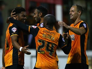 Chuba Akpom of Hull City celebrates with his team mate Ahmed El Mohamady after scoring the first goal in extra time during the Capital One Cup First Round match between Accrington Stanley and Hull City at Wham Stadium on August 11, 2015