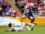 Swansea's Jack Cork takes on Jack Colback of Newcastle on August 15, 2015