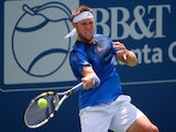 Jack Sock returns a forehand to Denis Kudla during the BB&T Atlanta Open at Atlantic Station on July 30, 2015 in Atlanta, Georgia.