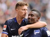 Jens Hegeler congratulates Salomon Kalou after he scores a penalty for Hertha Berlin against Augsburg on August 15, 2015
