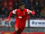 Jobi McAnuff of Leyton Orient looks to get past Jordan Turnball of Swindon during the Sky Bet League One match between Leyton Orient and Swindon Town at The Matchroom Stadium on October 04, 2014