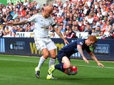 Swansea's Jonjo Shelvey tackles flame-haired opponent Jack Colback of Newcastle on August 15, 2015