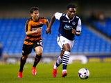 Fred Onyedinma of Millwall moves away from Luke Gambin of Barnet during the Capital One Cup First Round match between Millwall and Barnet at The Den on August 11, 2015
