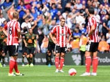 Oriol Romeu and Southampton teammates are down in the dumps after losing to Everton in the early kickoff on August 15, 2015