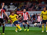 John Mullins of Oxford United scores Oxford's 4th goal during the Capital One Cup First Round match between Brentford and Oxford United at Griffin Park on August 11, 2015
