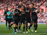 Liverpool players celebrate with Philippe Coutinho after the Brazilian's winning goal against Stoke City in the Premier League on August 9, 2015