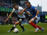 Ben Davies of Portsmouth is tackled by Andreas Weimann of Derby County during the Capital One Cup First Round match between Portsmouth v Derby County at Fratton Park on August 12, 2015