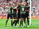 Romelu Lukaku celebrates his first goal with Everton teammates on August 15, 2015