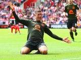 Ross Barkley opts for jazz hands as he celebrates scoring Everton's third against Southampton on August 15, 2015