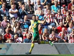 Norwich's Russell Martin celebrates scoring the opener against Sunderland on August 15, 2015