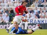 Ruud van Nistelrooy celebrates scoring for Manchester United on August 23, 2003