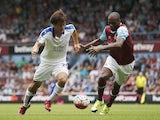 Leicester's Shinji Okazaki takes on Angelo Ogbonna of West Ham on August 15, 2015