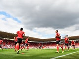 Southampton players warm up ahead of the game with Everton on August 15, 2015