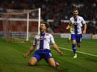 Tom Bradshaw of Walsall celebrates scoring the winning goal during the Capital One Cup First Round match between Nottingham Forest and Walsall at City Ground on August 11, 2015
