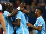 Yaya Toure of Manchester City (2L) is congratulated by team mates as he scores their first goal during the Barclays Premier League match between West Bromwich Albion and Manchester City at The Hawthorns on August 10, 2015