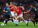 Adnan Januzaj of Manchester United goes past Oscar Duarte of Club Brugge during the UEFA Champions League Qualifying Round Play Off First Leg match between Manchester United and Club Brugge at Old Trafford on August 18, 2015