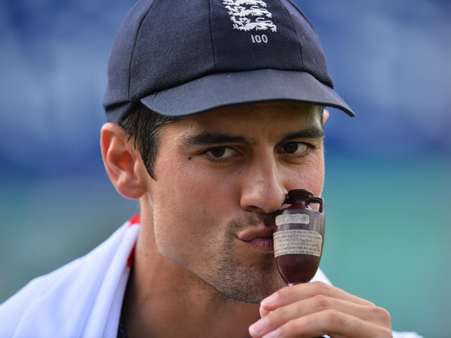 England's captain Alastair Cook kisses the replica Ashes urn as England celebrate their series victory after the fourth day of the fifth Ashes cricket test match between England and Australia at The Oval cricket ground in London, on August 23, 2015