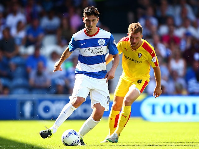 Alejandro Faurlin of QPR takes the ball past Lee Frecklington of Rotherham during the Sky Bet Championship match between Queens Park Rangers and Rotherham United at Loftus Road on August 22, 2015