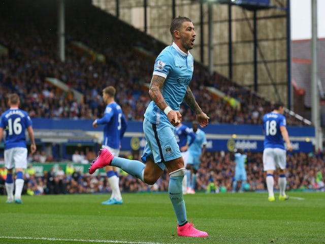 Aleksandar Kolarov of Manchester City celebrates scoring the opening goal during the Barclays Premier League match between Everton and Manchester City at Goodison Park on August 23, 2015