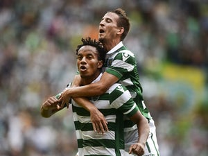 Sporting Lisbon move joint-top with win