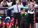 Arsenal boss Arsene Wenger gesticulates during his side's game with Crystal Palace on August 16, 2015