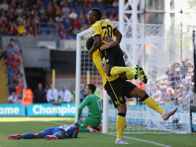 Adama Traore and Rudy Gestede of Aston Villa celebrate their team's third goal scored by Pape N'Diaye Souare of Crystal Palace (1st L) during the Barclays Premier League match between Crystal Palace and Aston Villa at Selhurst Park on August 22, 2015