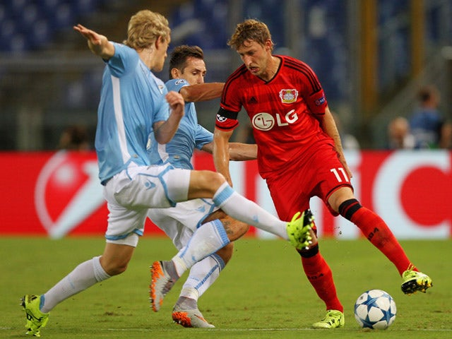 Stefan Kiessling (R) of Bayer Leverkusen competes for the ball with Miroslav Klose (C) and Dusan Basta of SS Lazio during the UEFA Champions League qualifying round play off first leg match between SS Lazio and Bayer Leverkusen at Olimpico Stadium on Augu