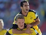 Dortmund's defender Matthias Ginter (L) and his teammate Dortmund's Armenian midfielder Henrikh Mkhitaryan (R) celebrate after the first goal for Dortmund during the German first division Bundesliga football match FC Ingolstadt 04 vs Borussia Dortmund, on