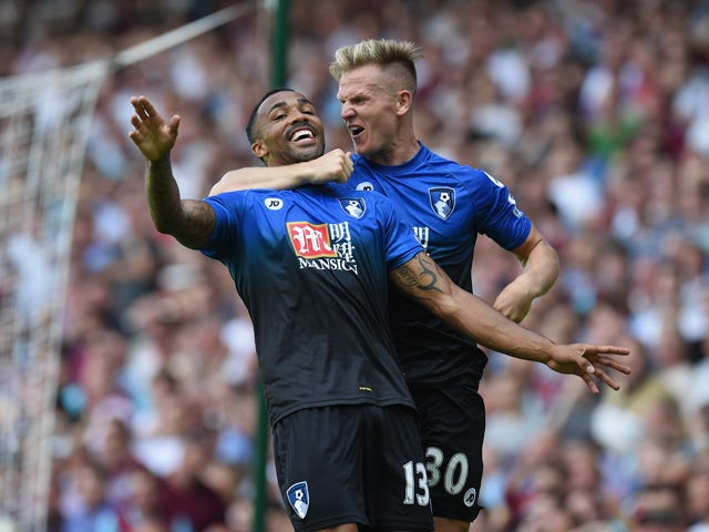 Callum Wilson (L) of Bournemouth celebrates scoring his team's second goal with his team mate Matt Ritchie (R) during the Barclays Premier League match between West Ham United and A.F.C. Bournemouth at the Boleyn Ground on August 22, 2015